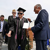 Leominster high School class of 2018 held their 148th commencement on Saturday, June 2, 2018. Mayor Dean Mazzarella, on right, gives WWII veteran Roland Martineau, 94, his well overdue Leominster High School diploma at the start of the ceremony. SENTINEL & ENTERPRISE/JOHN LOVE