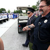 Leominster high School class of 2018 held their 148th commencement on Saturday, June 2, 2018. Roland Martineau, 94, makes his way onto the football field with the help of Firefighter Bob Penning to finally receive his 1942 high school diploma. SENTINEL & ENTERPRISE/JOHN LOVE