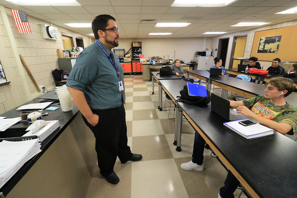 . Leominster High School Principals of Technology teacher Carlos Silva, 29, in his classroom on Thursday, September 20, 2018. He became a United States citizen on Wednesday in a ceremony in Lowell. He moved to Leominster with his family when he was very young. He is also a graduate of LHS. SENTINEL & ENTERPRISE/JOHN LOVE