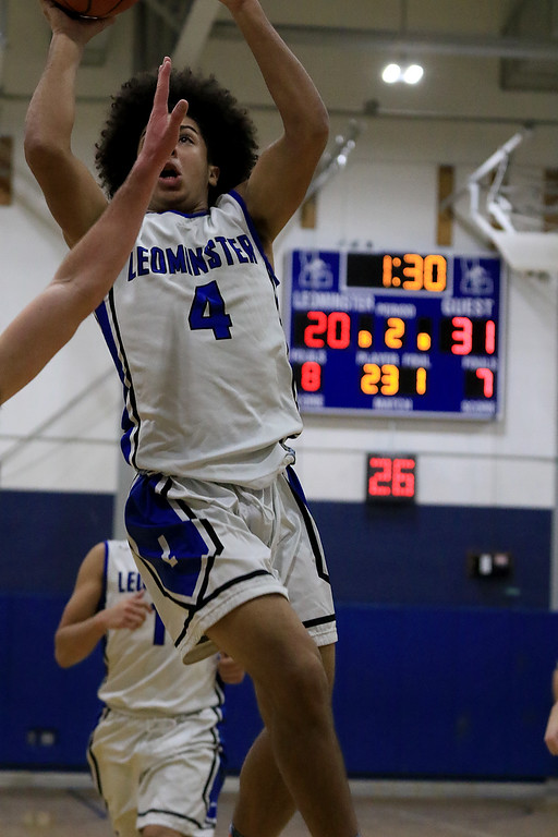 . Leominster High School basketball played Westborough High School on Tuesday night at home. LHS\'s Brian Rodriguez makes a shot. SENTINEL & ENTERPRISE/JOHN LOVE