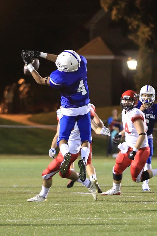 . LHS Brian Rodriguez attemps the catch SENTINEL&ENTERPRISE/Scott LaPrade