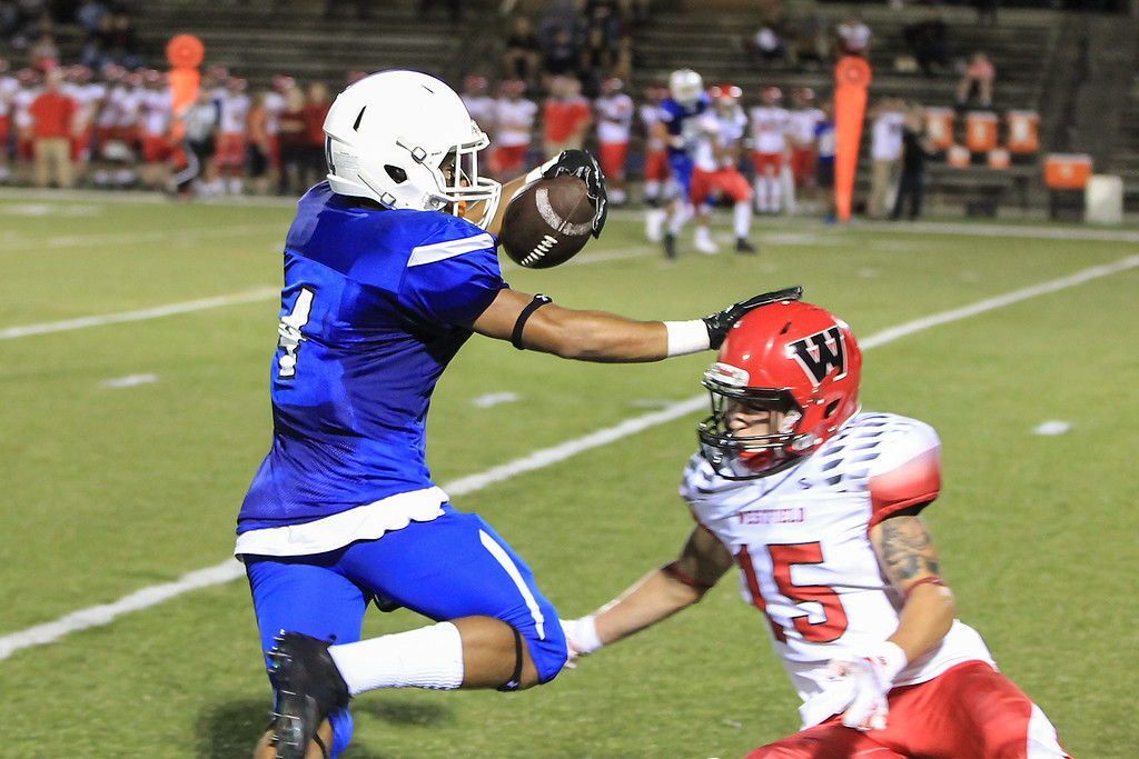 . LHS Brian Rodriguez pushes off a Westfields player after a catch and run SENTINEL&ENTERPRISE/Scott LaPrade