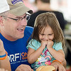 Joe Reploe and daughter Tessa, 2,  during the International Food Festival at Holy Family of Nazareth Parish in Leominster. SENTINEL & ENTERPRISE / Ashley Green