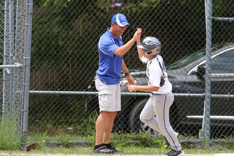 Lunenburg player Miles Seminatore high fives his coach as he rounds third after he hit a home run against North Leominster at the Jimmy Fund playoff game on Saturday. SENTINEL & ENTERPRISE/JOHN LOVE