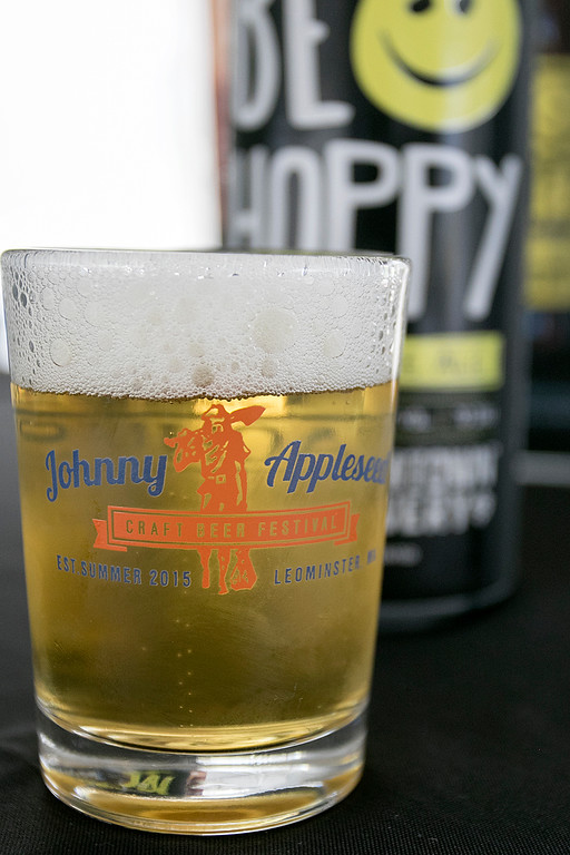. The annual Leominster Johnny Appleseed Craft Beer Festival was held Saturday, August 3, 2019. They had around 40 venders at the event with many of their beers. They gave out small shot glasses for tasting the beer during the event. This shot holds the Be Hoppy India pale Ale from Wormtown Brewery. SENTINEL & ENTERPRISE/JOHN LOVE