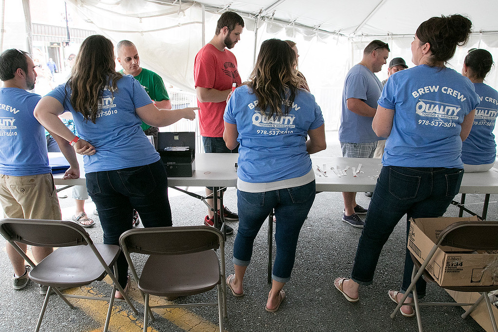 . The annual Leominster Johnny Appleseed Craft Beer Festival was held Saturday, August 3, 2019. They had around 40 venders at the event with many of their beers. The Beer Crew checks people in. SENTINEL & ENTERPRISE/JOHN LOVE