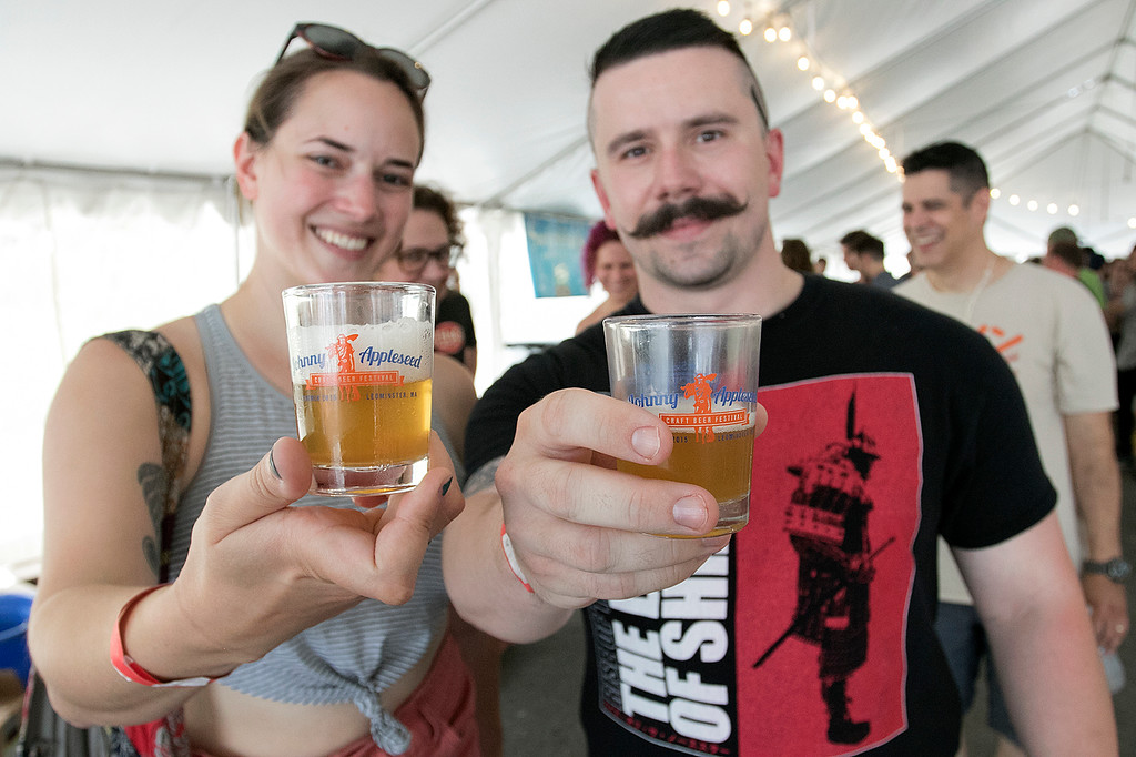 . The annual Leominster Johnny Appleseed Craft Beer Festival was held Saturday, August 3, 2019. They had around 40 venders at the event with many of their beers. Enjoying themselves at the festival is Kris Polk and John Braun from Fitchburg. SENTINEL & ENTERPRISE/JOHN LOVE