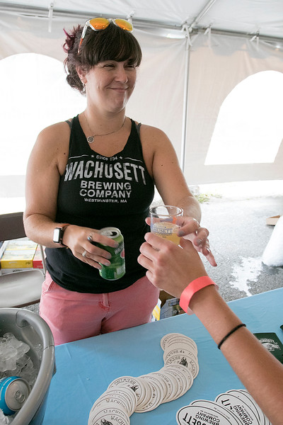 The annual Leominster Johnny Appleseed Craft Beer Festival was held Saturday, August 3, 2019. They had around 40 venders at the event with many of their beers. Julie Whittemore with Wachusett Brewing Company pours one of their beers for a festival goers. SENTINEL & ENTERPRISE/JOHN LOVE