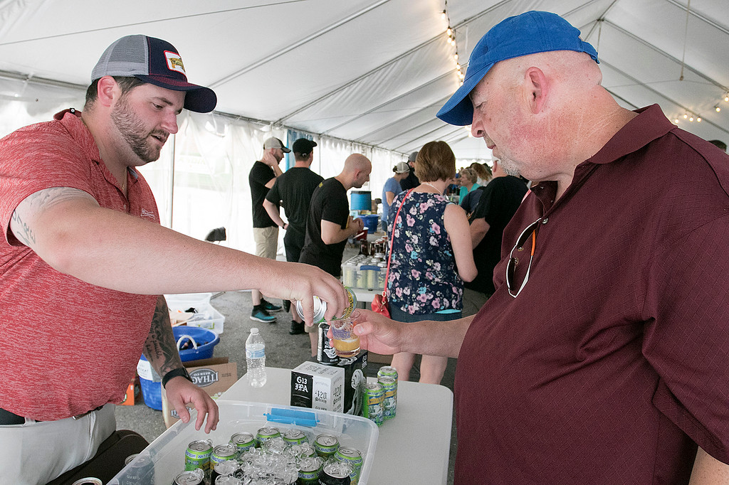 . The annual Leominster Johnny Appleseed Craft Beer Festival was held Saturday, August 3, 2019. They had around 40 venders at the event with many of their beers. Kyle Cellana with Sweet Water Brewing Company pours an IPA for Ed Desgroseilliers from Fitchburg. SENTINEL & ENTERPRISE/JOHN LOVE