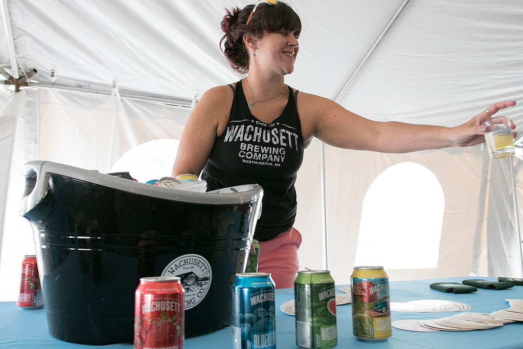 . The annual Leominster Johnny Appleseed Craft Beer Festival was held Saturday, August 3, 2019. They had around 40 venders at the event with many of their beers. Julie Whittemore with Wachusett Brewing Company pours one of their beers for a festival goers. SENTINEL & ENTERPRISE/JOHN LOVE
