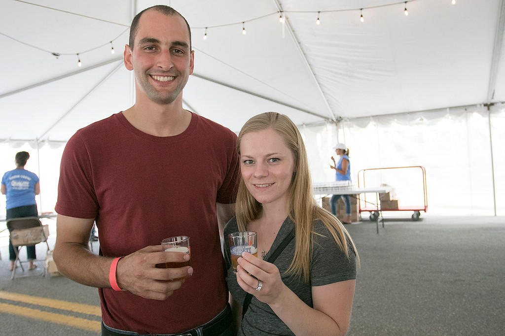 . The annual Leominster Johnny Appleseed Craft Beer Festival was held Saturday, August 3, 2019. They had around 40 venders at the event with many of their beers. Enjoying themselves at the festival is Joe and Casey Poirier from Ashburnham. SENTINEL & ENTERPRISE/JOHN LOVE