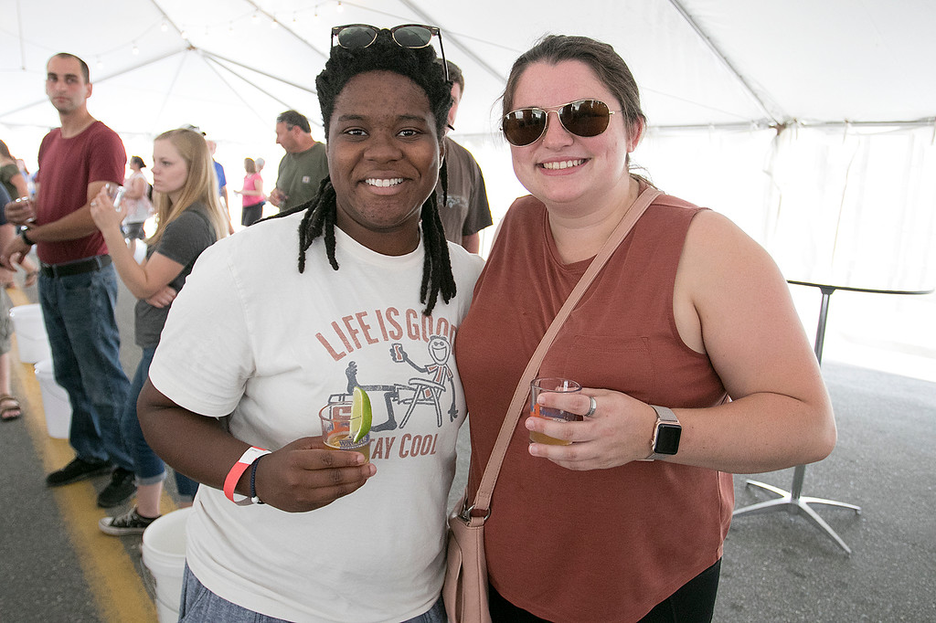 . The annual Leominster Johnny Appleseed Craft Beer Festival was held Saturday, August 3, 2019. They had around 40 venders at the event with many of their beers. Enjoying themselves at the festival is Christie Idiong from Springfield and Abbie King from North Andover. SENTINEL & ENTERPRISE/JOHN LOVE