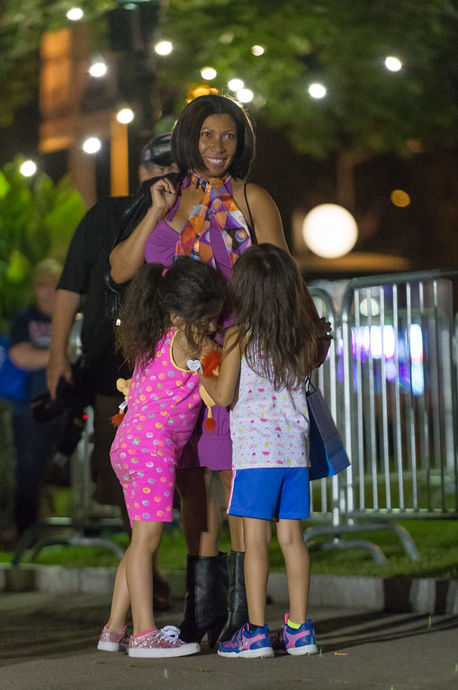 . A model is greeted by her children on the Monument Square runway during the Ladies Night Out Fashion Show which featured local models, fashions makeup and hair. SENTINEL&ENTERPRISE/ Jim Marabello