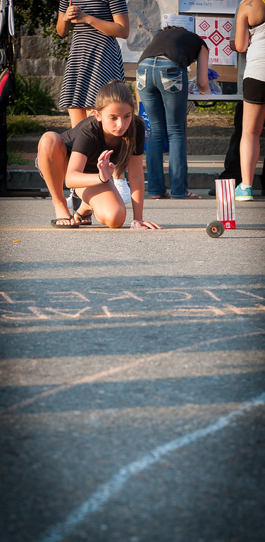 . Patience Virtue of Leominster tries rolling the wheel of a roller skate towards a target to win free tickets to the Bay State Brawlers roller derby during Ladies Night Out in Leominster. SENTINEL&ENTERPRISE/ Jim Marabello