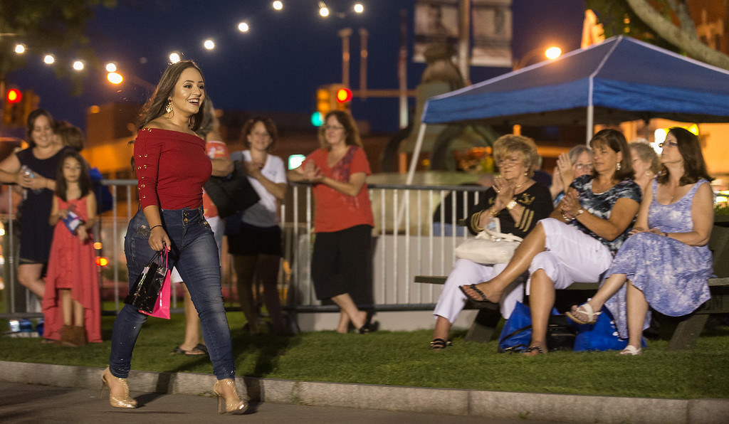 . A model walks the Monument Square runway during the Ladies Night Out Fashion Show which featured local models, fashions makeup and hair. SENTINEL&ENTERPRISE/ Jim Marabello