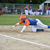 Sage Bray of Leominster Legion dives back into first after a pick off attempt by Framingham pitcher  during Monday night's game in Leominster.  SENTINEL & ENTERPRISE JEFF PORTER
