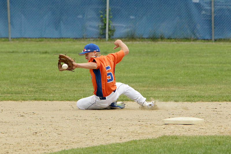 Leominsters Andrew Harrington makes a great grab from a hit making the out