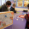 Brothers Ilan, 9, Erez, 7, and Oren Cohem, 16, worked on a Color-Me Puzzle at the Leominster Public Library on Thursday morning, December 27, 2018 during the library program. SENTINEL & ENTERPRISE/JOHN LOVE