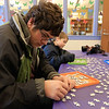 Brothers Ilan, 9, Erez, 7, and Oren Cohen, 16, worked on a Color-Me Puzzle at the Leominster Public Library on Thursday morning, December 27, 2018 during the library program. Oren looks over his pieces as he works to put the puzzle together with his brothers. Oren looks over the pieces as he tries to put the puzzle together with his brothers. SENTINEL & ENTERPRISE/JOHN LOVE