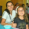 Tania Brito and daughter, Rafaela Rocha from Leominster were all smiles at a program at the Leominster Public Library Monday afternoon.<br /> Sentinel & Enterprise / Jim Fay