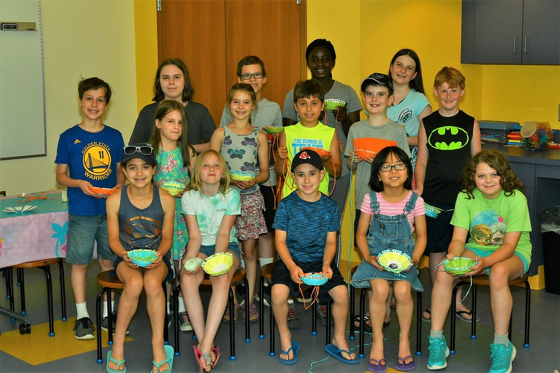 The students participating in a program at the Leominster Public Library Monday afternoon show off their creations.<br /> Sentinel & Enterprise / Jim Fay
