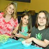 Sarah , Melanie and Tiffany Sosa were weaving baskets at the program at the Leominster Public Library Monday afternoon. The Sosas are from Leominster.<br /> Sentinel & Enterprise / Jim Fay