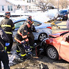 Leominster ff's use the jaws of life to free victim -2 car MVA - North Main St & Priest St