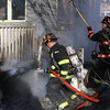 Ff Paul Apollonio hits the fire under the deck with an attack line
