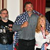 H.O.G. (Harley Owners Group) Local  President, Jeff Boulay  stands with John & Pauline Roberge who are draped in the Quilt given in memory of their Son, Jonathan Roberge.  The H.O.G. and Quilts of Valor gave the Quilt to the Roberge's.  Sentinel & Enterprise/ Jim Fay