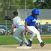 National Angel Baez beats out the run to 1st base with Reece Lora on 1st