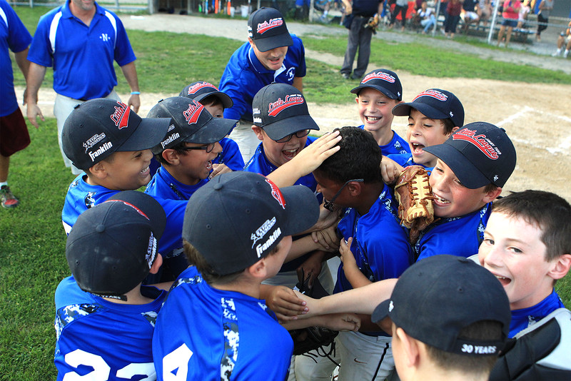 Leominster National players celebrate, with closer Angel Baez in the center, after defeating Leominster American in the Jimmy Fund Open Division championship game in Leominster on Friday, Aug. 5, 2016. SENTINEL & ENTERPRISE / SCOTT LAPRADE