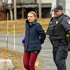 Leominster Police Officer Carlos Cintron brings out the suspect of the breakin<br /> SENTINEL&ENTERPRISE/Scott LaPrade