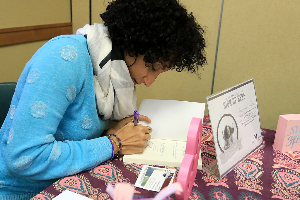 . The Leominster Public Library held a series of lectures from local authors on Saturday, October 13, 2018. Maria M Vazquez signs her book Super Sparkly Everything at the event. SENTINEL & ENTERPRISE/JOHN LOVE