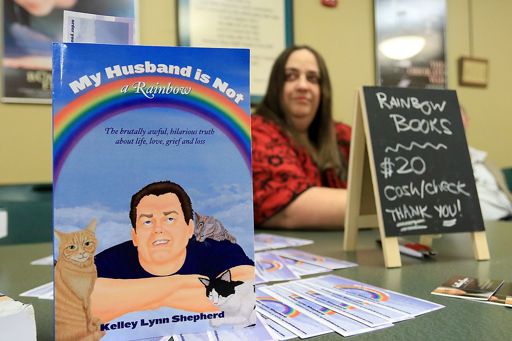 . The Leominster Public Library held a series of lectures from local authors on Saturday, October 13, 2018. Kelly Lynn shepherd sits at her talbe at the event with her book My Husband is not a Rainbow. SENTINEL & ENTERPRISE/JOHN LOVE