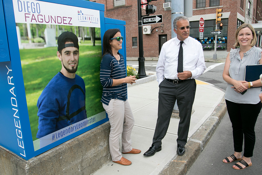 . Mayor Dean Mazzarella talk on Tuesday, July 16, 2019 about the City rebranding itself. Mazzarella, center, stands next to one of the five new legendary people signs that they have put up aound the city to show off some of the people that make Leominster Leominster with, from left, Small Business Coordinator Melissa Tasca and Nikki Peters the economic development coordinator for the city. This one is of new England Revolution player Diego Fagundez is located on main Street. SENTINEL & ENTERPRISE/JOHN LOVE