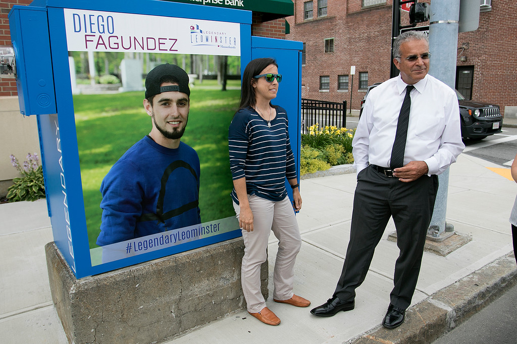 . Mayor Dean Mazzarella talk on Tuesday, July 16, 2019 about the City rebranding itself. Mazzarella, center, stands next to one of the five new legendary people signs that they have put up aound the city to show off some of the people that make Leominster Leominster with Small Business Coordinator Melissa Tasca. This one is of new England Revolution player Diego Fagundez is located on main Street. SENTINEL & ENTERPRISE/JOHN LOVE