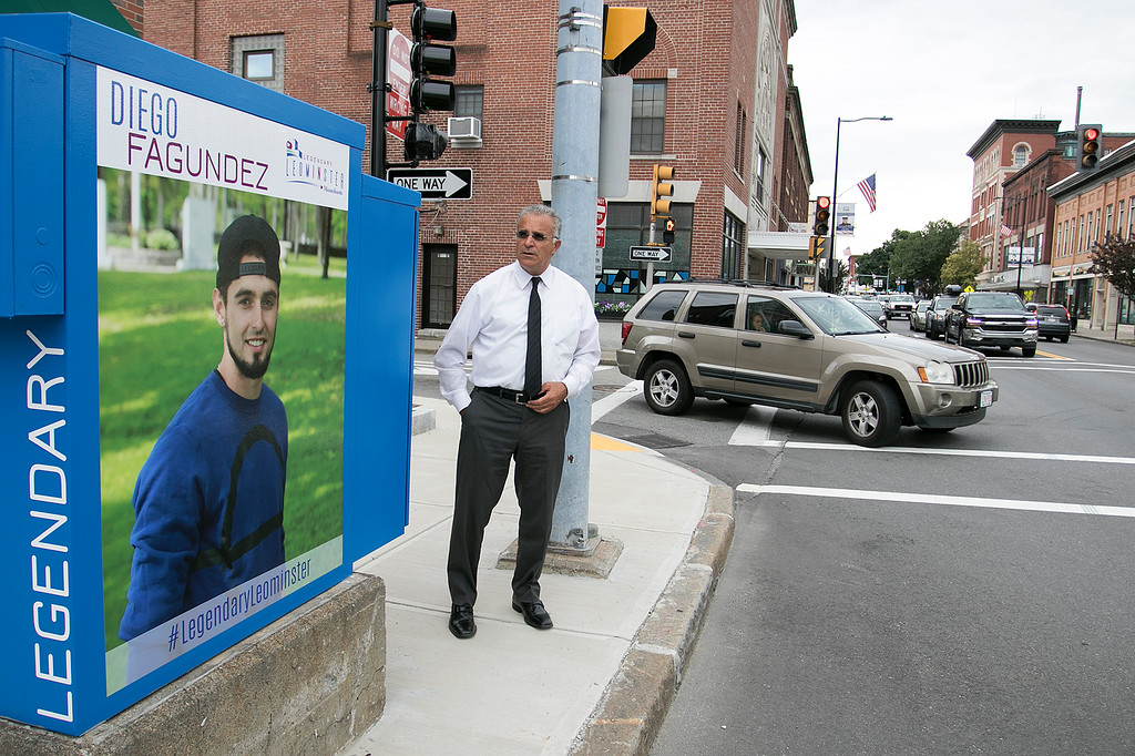 . Mayor Dean Mazzarella talk on Tuesday, July 16, 2019 about the City rebranding itself. Here he stands next to one of the five new legendary people signs that they have put up aound the city to show off some of the people that make Leominster Leominster. This one is of new England Revolution player Diego Fagundez is located on main Street. SENTINEL & ENTERPRISE/JOHN LOVE