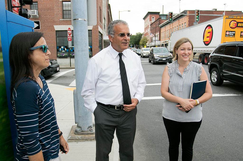 . Mayor Dean Mazzarella talk on Tuesday, July 16, 2019 about the City rebranding itself. Mazzarella, center, stands next to one of the five new legendary people signs that they have put up aound the city to show off some of the people that make Leominster Leominster with, from left, Small Business Coordinator Melissa Tasca and Nikki Peters the economic development coordinator for the city. This one is of new England Revolution player Diego Fagundez. SENTINEL & ENTERPRISE/JOHN LOVE
