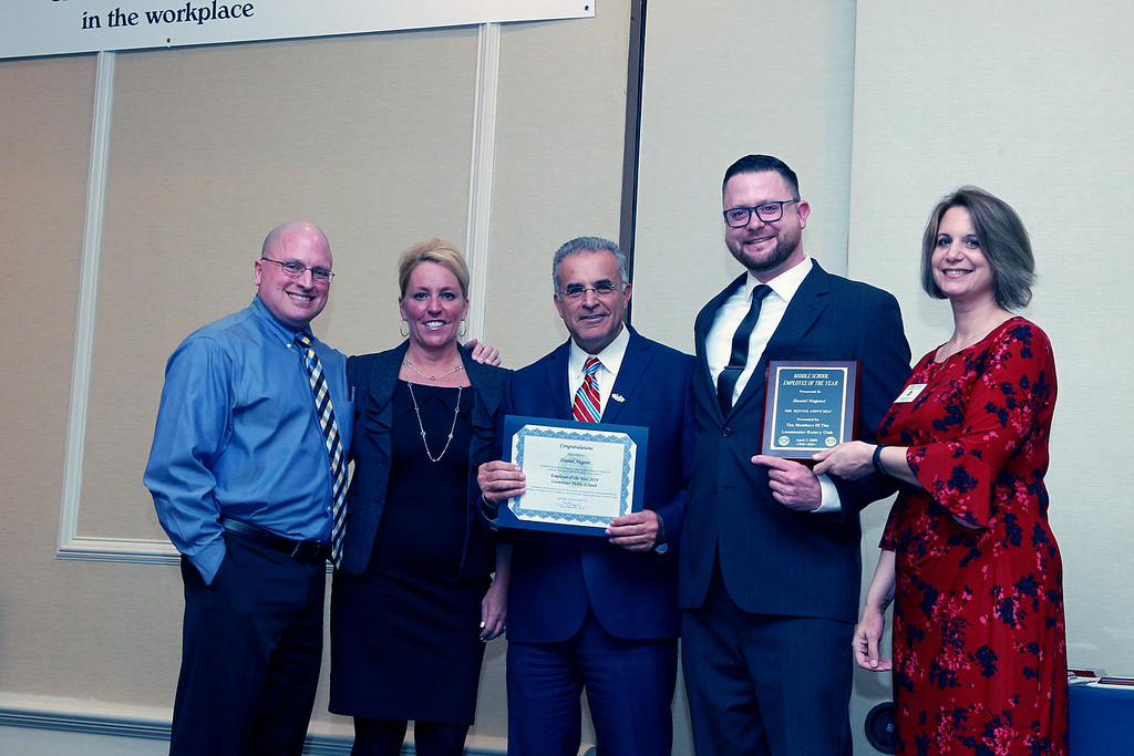 . (From left) Sky View Middle School Assistant Principal Douglas Nebel, Leominster Schools\' Superintendent Paula Deacon, Mayor Dean Mazzarella, stand with Sky View\'s Employee of the Year Daniel Nugent and Mary Dean with the Leominster Rotary Club. SENTINEL & ENTERPRISE/VINCENT APOLLONIO
