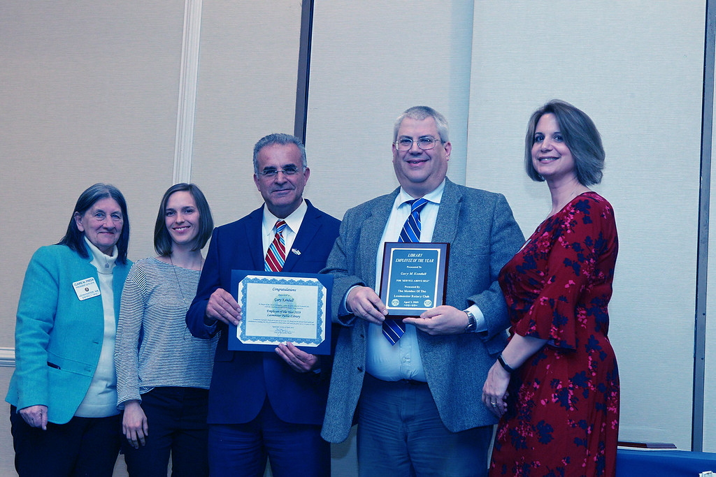 . (From left) The Rotary Club\'s Claire Freda, Leominster Public Library Director Sondra Murphy, and Mayor Dean Mazzarella stand with Gary Kendall, the Library\'s Employee of the Year. They are joined by Mary Dean. SENTINEL & ENTERPRISE / VINCENT APOLLONIO
