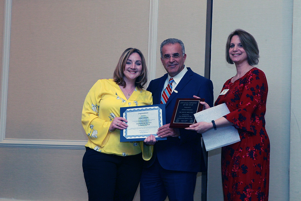 . (From left) Jolene Constant, administrative assistant for the Veterans\' Services Department, was named City Hall Employee of the Year and stands with Leominster Mayor Dean Mazzarella Mayor and Mary Dean with the Rotary Club. SENTINEL & ENTERPRISE / VINCENT APOLLONIO