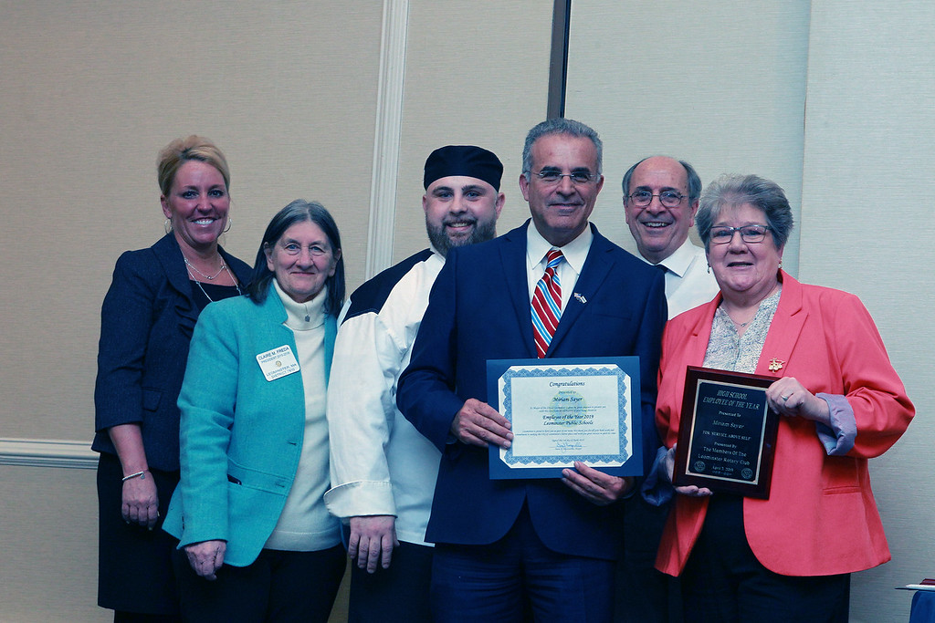 . (From left) Leominster Schools\' Superintendent Paula Deacon, The Rotary Club\'s Claire Freda, John Ciccone , Mayor Dean Mazzarella, and Leominster Center for Technical Excellence Innovation\'s Director David Fiandaca stand with Miriam Sayer, who was named the High School\'s Employee of the Year during the awards and presentation dinner Wednesday night at the Doubletree in Leominster. SENTINEL & ENTERPRISE/VINCENT APOLLONIO