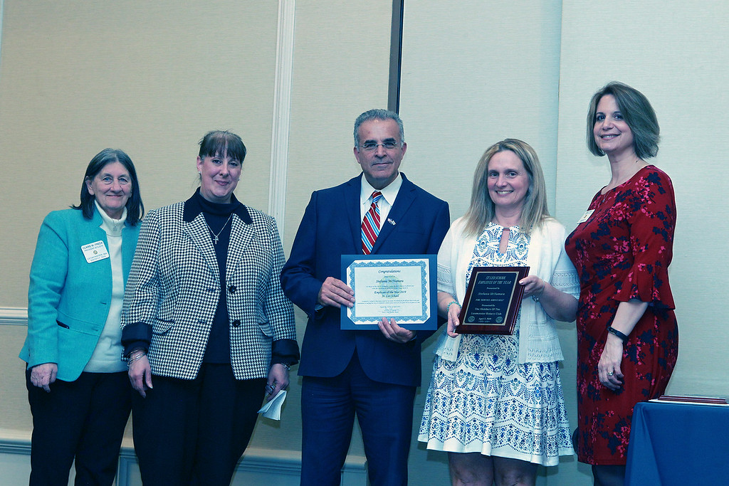 . (From left) The Rotary Club\'s Claire Freda, St. Leo\'s Catholic School\'s Principal Nancy Pierce, and Mayor Dean Mazzarella stand with Stefania McNamara, St. Leo\'s Catholic School\'s Employee of the Year. They are joined by The Rotary Club\'s Mary Dean. SENTINEL & ENTERPRISE / VINCENT APOLLONIO