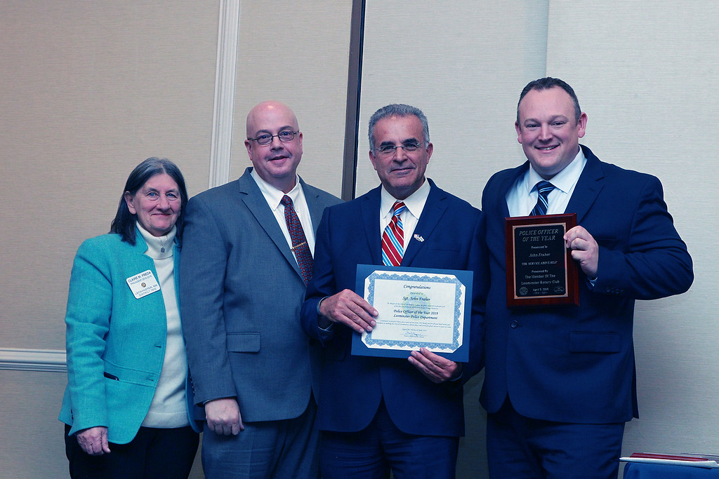. (From left) The Rotary Club\'s Claire Freda, interim Police Chief Michael Goldman, and Mayor Dean Mazzarella, stand with Sgt. John Fraher, the Leominster Police Department\'s Employee of the Year. SENTINEL & ENTERPRISE / VINCENT APOLLONIO