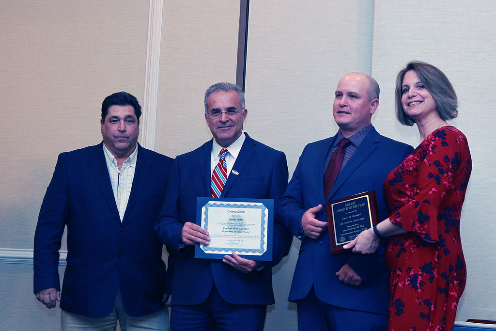 . (From left) The Department of Public Works\'s Director Raymond Racine, and Mayor Dean Mazzarella stand with Jeremy Babin, who was the DPW\'s Employee of the Year. They are joined by the Rotary Club\'s Mary Dean. SENTINEL & ENTEPRISE /VINCENT APOLLONIO