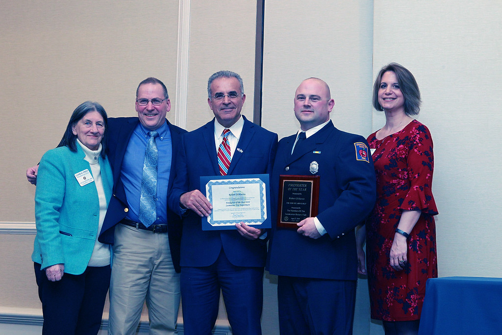 . (From left) The Rotary Club\'s Claire Freda, Fire Chief Robert Sideleau, and Mayor Dean Mazzarella stand with Firefighter Robert DiMarzio, the Fire Department\'s Employee of Year. They are joined by The Rotary Club\'s Mary Dean . SENTINEL & ENTERPRISE /VINCENT APOLLONIO