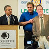Mayor Dean Mazzarella presents Bill Mitchell, in cardboard cutout form, held by David Smith of the DPW, with the City Hall Employee of the Year Award during the Leominster Rotary Club's 23rd Annual Vocational Awards Dinner at the DoubleTree by Hilton Hotel in Leominster on Wednesday, March 20, 2017. SENTINEL & ENTERPRISE / Ashley Green