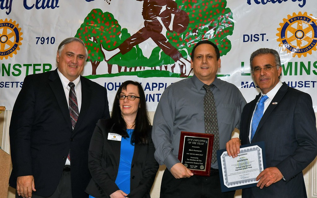 . Department of Public Works Business Manager Roger Brooks, Leominster Rotary President Jennifer Stacy stand Leominster DPW Employee of the Year Mark Piermarini and Mayor Dean Mazzarella. Jim Fay / Sentinel & Enterprise