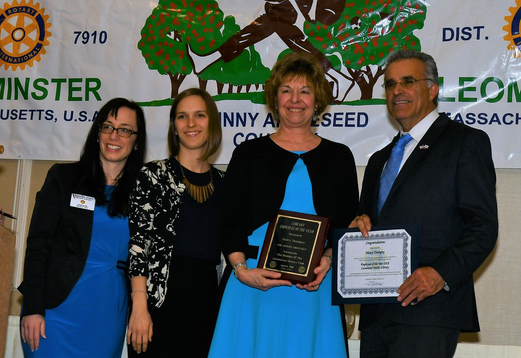 . Leominster Rotary President Jennifer Stacy stands with Library Director Sondra Murphy, Library Employee of the Year Nancy Tourigny and Mayor Dean Mazzarella. Jim Fay / Sentinel & Enterprise