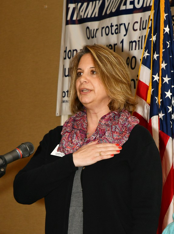 . The Leominster Rotary Club\'s Mary Dean sings the National Anthem. Jim Fay / Sentinel & Enterprise